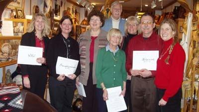 Don Ward (center back) and Jennifer Eis (far right) of Ward & Eis Gallery present donations to several local non-profit organizations, based on a percentage of their gallery proceeds for 2012. Gallery manager Kathy Goodwin (third from right) also was on hand for the presentation. Receiving the donations are (from left) Gail Kloss of Womens Resource Center of Northern Michigan, Sue Engel of Friendship Centers, Kathy Hart of The Manna Food Project, Niki Kenny of Community Free Clinic and Mike Walker of Nehemiah House. Absent from the photo is Jama Moffett of donation recipient Petoskey Club.