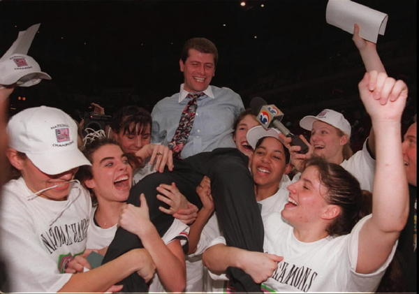 UConn Women's Basketball wins their First National Championship. UConn defeated Tennessee 70-64 in the final four game. Carla Berube, Missy Rose, Kara Wolters, Rebecca Lobo, Nykesha Sales, Jen Rizzotti and Brenda Marquis hold up Coach Auriemma after winning his first national title.