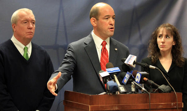 DuPage County State's Attorney Robert Berlin, center, is joined by DEA Special Agent in Charge, Jack Riley, left, and Chief of the State's Attoney's narcotics unit Audriana Anderson at a press conference in Wheaton today. A DuPage County judge set a cash bail of $750,000 for each of three Schaumburg police officers accused of ripping off drug dealers. A female companion of one of the officers was also charged. The accused officers are John Cichy, 30, Matthew Hudak, 29, and Terrance O'Brian, 47.