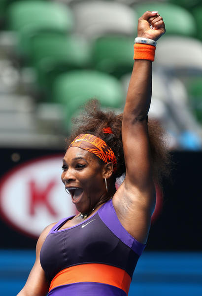 Serena Williams of the United States of America celebrates winning her second round match against Garbine Muguruza of Spain during day four of the 2013 Australian Open at Melbourne Park on January 17, 2013 in Melbourne, Australia.