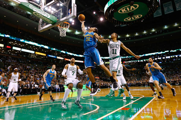 Brian Roberts #22 of the New Orleans Hornets goes up for a layup in front of Courtney Lee #11 of the Boston Celtics during the game on January 16, 2013 at TD Garden in Boston, Massachusetts.