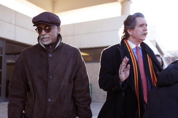 State Sen. Donne Trotter listens as his lawyer, Thomas Durkin, speaks with reporters outside the Cook County Criminal Court, in Chicago, after a hearing on charges of bringing a handgun into O'Hare International Airport.