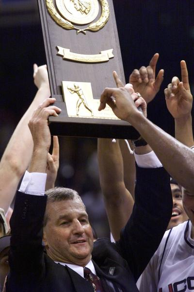 UConn Basketball wins their first National Championship. The Huskies defeated Duke 77-74. Coach Jim Calhoun holds up the championship trophy.