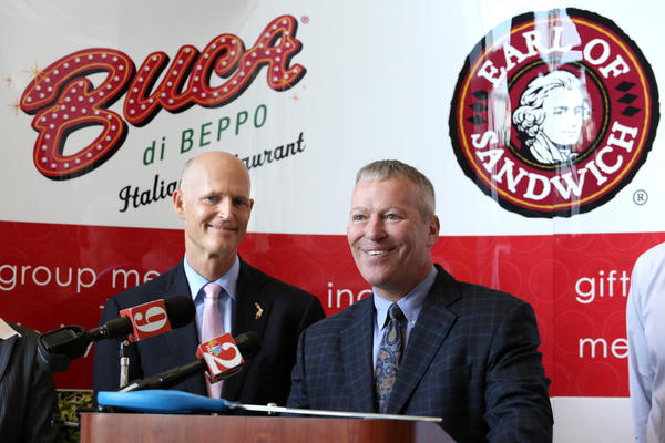 Governor Rick Scott  and Orlando Mayor Buddy Dyer at the ribbon-cutting ceremony commemorating the moving of the Buca di Beppo restaurant chain --from Minneapolis  to the new Earlenterprises, formerly Planet Hollywood International, headquarters in Orlando, Thursday, January 17, 2013.