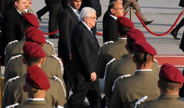 Palestinian Authority President Mahmoud Abbas, center, shown reviewing the honor guards during a visit Sunday to Tunis, Tunisia, will head a new unity government under an agreement announced Thursday between his Fatah movement and Hamas.