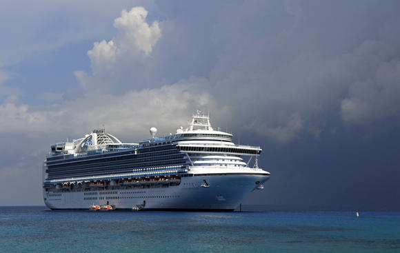 Crown Princess at anchor in the Caribbean.