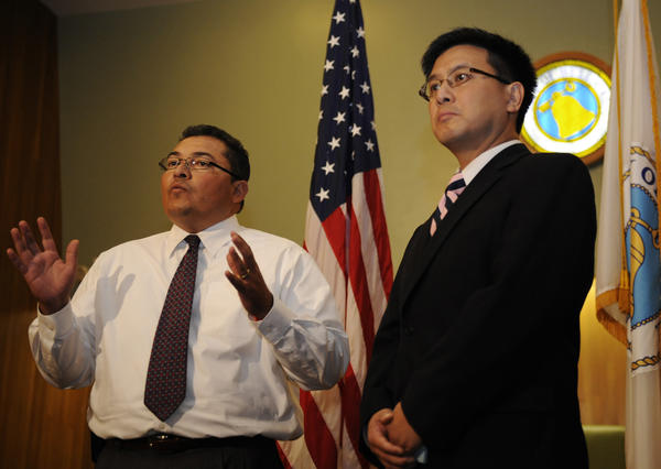 State Controller John Chiang, right, with Interim City Administrator Pedro Carrillo discuss an audit of Bell's finances.