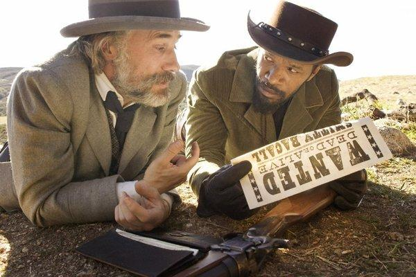"Christoph Waltz as Dr. King Schultz and Jamie Foxx as Django in Quentin Tarantino's film, ""Django Unchained."""
