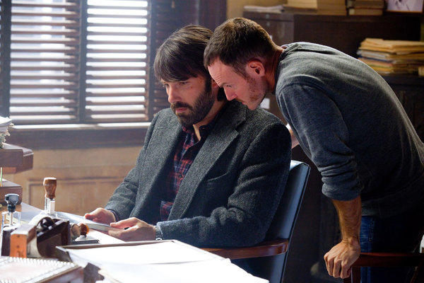 "Director Ben Affleck with screenwriter Chris Terrio on the set of the movie ""Argo."""