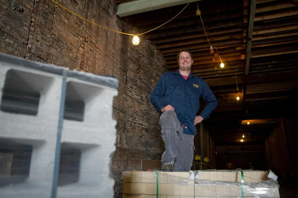 Frank Lassandrello, brewery manager of Broad Shoulders Brewing, stands amidst construction at their location on Motor Row.