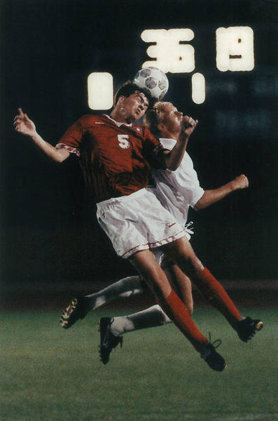 UConn Men' Soccer wins their third Big East Championship. Here is Stuart McRury(11) of the 1992 UConn soccer team and Gisle Sorligose(5) of Boston University going up for a header during a game.