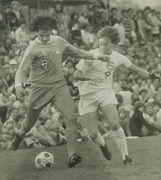UConn Men's Soccer team captured their first Big East Championship in 1983. The next year the Huskies continued their championship streak when they won the Big East title for the second consecutive year. This is a photo from the 1992 UConn Soccer team. Michael Howard defends Greg Mancuso from Rhode Island.