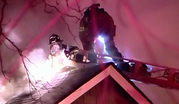 Firefighters work to extinguish a fire in a Berwyn home that killed a man Wednesday night.