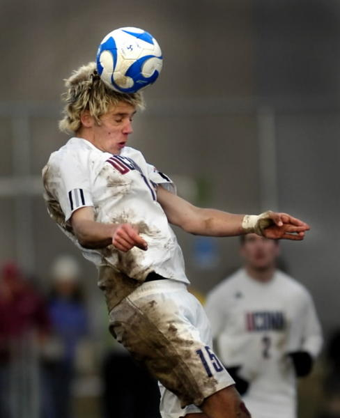 UConn Men's Soccer wins their seventh Big East Championship. Toni Stahl heads the ball during the game against Virginia Tech.