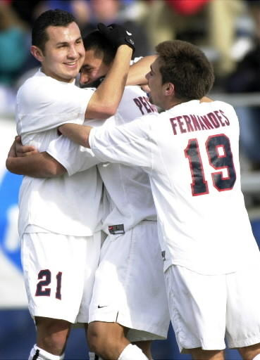 UConn Men's Soccer wins their fourth Big East Championship. Cesar Cuellar, Lindon Pecorelli and Rui Fernandes celebrate a UConn goal. (This is a photo from the 2000 UConn Soccer team.)