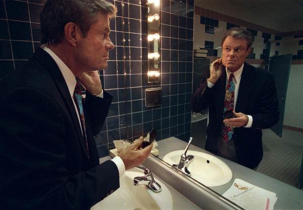 Dave Campbell stops in the men s room to apply some make-up to his face on the way to Studio A where he will be taping of  Baseball Tonight  at ESPN studios in Bristol.