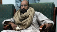 The son of the late strongman Moammar Kadafi appeared in a Libyan court  Thursday for the first time, facing charges tied to the controversial detention of his attorney last year.