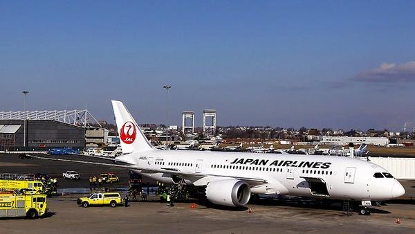Workers investigate a fire in a Boeing 787 Dreamliner operated by Japan Airlines at Boston's Logan International Airport.