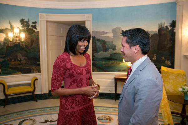 First Lady Michelle Obama sports a new hairstyle Thursday as she meets with David Hall, one of eight citizen co-chairs for the 2013 inauguration.