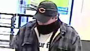 A Near North Side branch bank was robbed this afternoon by a man wearing a Bears hat, according to the FBI.