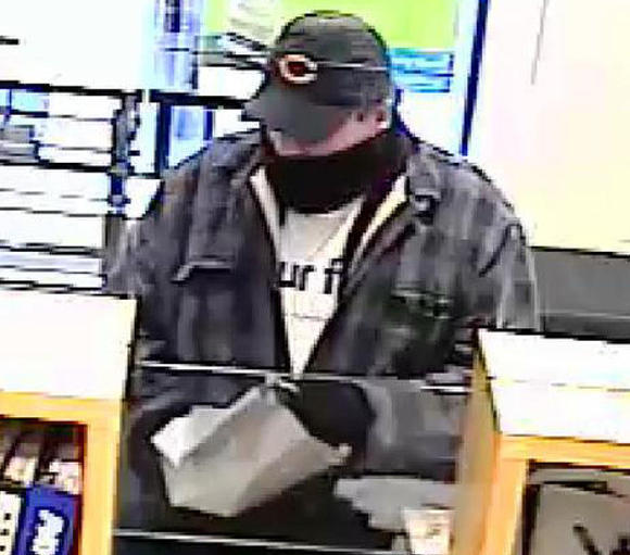 Surveillance photo of a man who robbed a Near North Side bank this afternoon. FBI photo