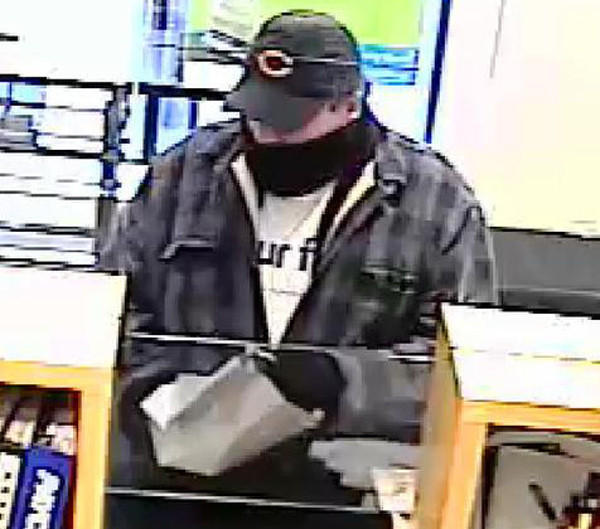 Surveillance photo of a man who robbed a Near North Side bank this afternoon.