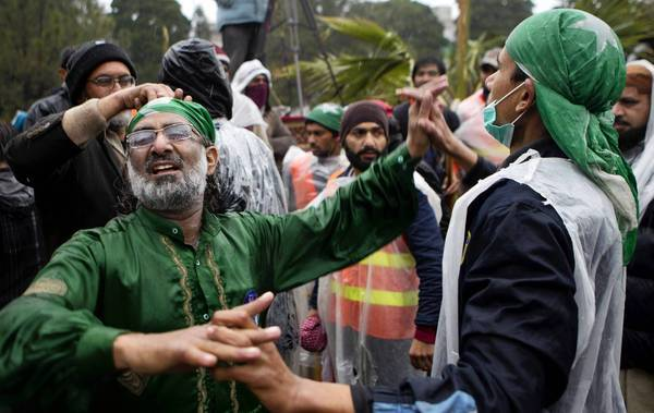 Pakistanis celebrate in Islamabad after cleric Tahirul Qadri gave the government a deadline on negotiations. Qadri ended a massive demonstration there after he and the government reached a deal on electoral reform.