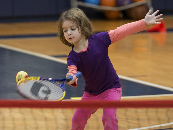 Elena Kaprowski, 4, of Coopersburg,, swings the racket during first session of tennis instruction for the children enrolled in the Early Child Education program at the Allentown Jewish Community Center.