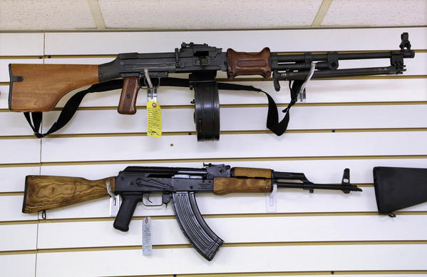Assault weapons are seen for sale at Capitol City Arms Supply Wednesday in Springfield, Ill. Most local law enforcement officials interviewed Thursday say they do not favor a ban on assault weapons.