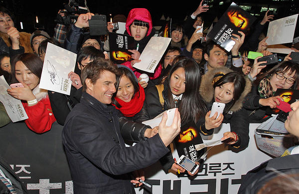 "Tom Cruise attends a ""Jack Reacher"" fan screening in Busan, South Korea on Jan. 10. The star's Beverly Hills home was the target of a ""swatting"" prank Thursday."