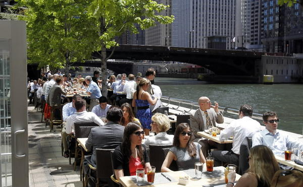 Lunchtime diners enjoy the patio at Bridge House Tavern, located along the Chicago River at 321 N. Clark St.