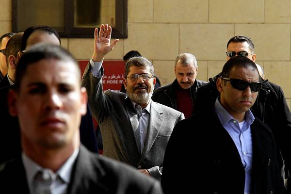 Egyptian President Mohamed Morsi waves to supporters in Cairo after a prayer service this month.