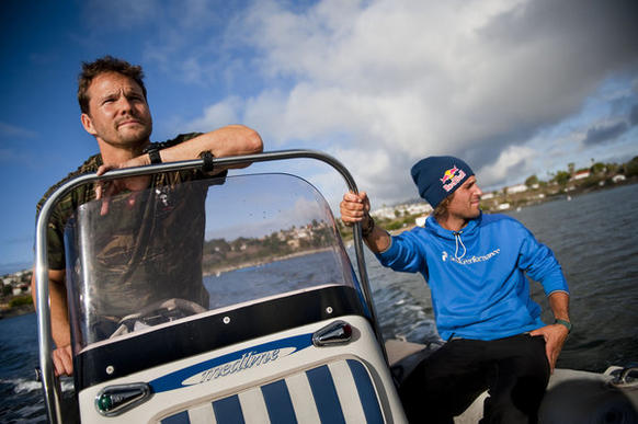 Actor Dylan Bruno pilots his Zodiak toward Catalina Island on a spearfishing trip while Bruno's friend, professional skier Henrik Windstedt of  Sweden, enjoys the ride.