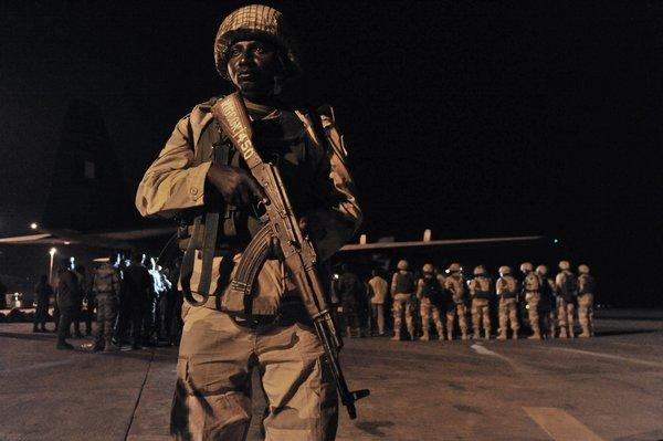 About 100 Nigerian troops, the first of a planned 3,300-member contingent from West African states, arrive in Mali's capital, Bamako, to join the fight against Al Qaeda-aligned Islamic militants who have seized the northern half of the country. French troops intervened a week ago with airstrikes and ground forces to avert the country's fall to the extremists.