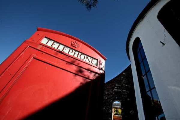 The Laguna Beach Arts Commission wants to convert Forest Avenue's infamous red telephone booth into a venue for a temporary sculpture exhibition project.