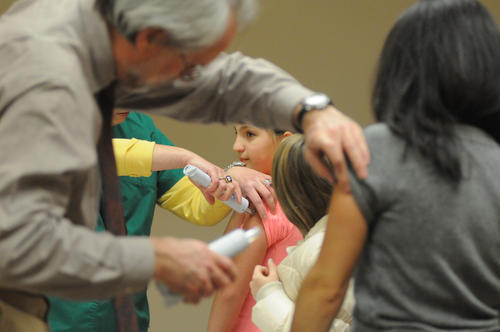 Julia Baldwin, 9, gets her flu shot Thursday.