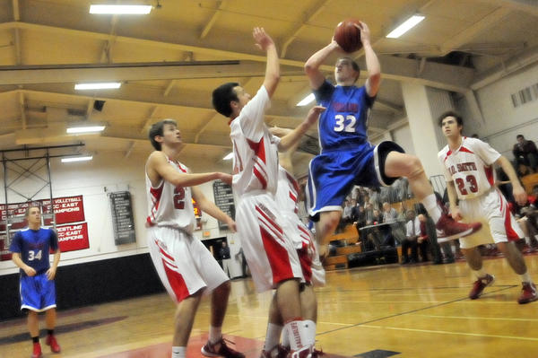 Taylor Fortin of Tolland High School attempts a shot surrounded by E.O. Smith players. E.O. Smith won, 78-53.