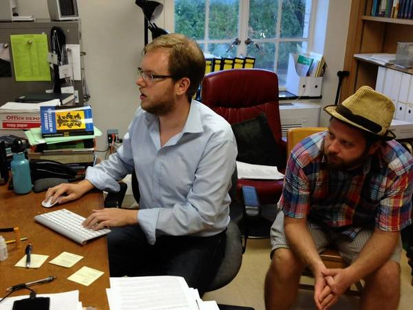 Lars Hinrichs, left, an assistant professor of English at the University of Texas, works with doctoral student Axel Bohmann on research into how Texas' regional dialect is changing.