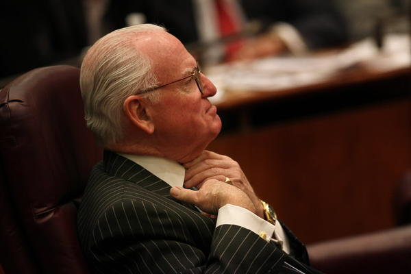 Ald. Ed Burke (14th) fixes his tie during a City Council meeting last month.