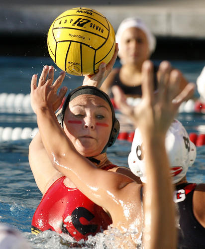 Burroughs' Emilee Holgate rises and takes a shot to score her team's first goal, despite the defense of Glendale's Rima Gasparian in the first quarter in a Pacific League girls water polo match at Burroughs High School in Burbank on Thursday, January 17, 2013.