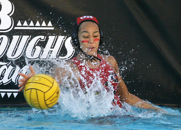 Burroughs' goal keeper Asha Earwood stops a Glendale sho in the first quarter in a Pacific League girls water polo match at Burroughs High School in Burbank on Thursday, January 17, 2013.