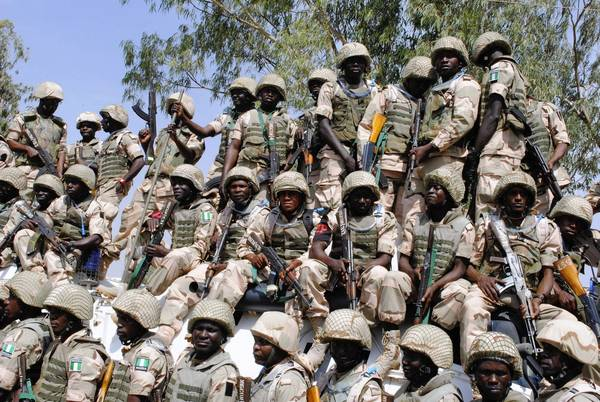 Nigerian troops in the military town of Jaji prepare to depart for Mali.