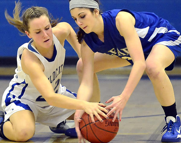 Williamsport's Kate Wade, left, tries to steal the ball from Clear Spring's Isabel Forsman during Thursday night's MVAL Antietam girls basketball game at Williamsport.