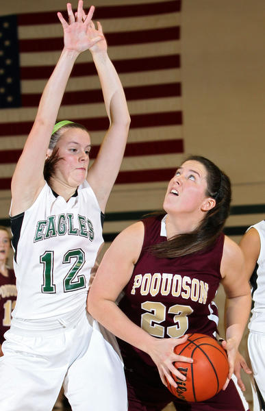 Sydney Turner of Poquoson looks for a shot over Samantha McLaughlin of Jamestown during the second half Thursday at Jamestown.