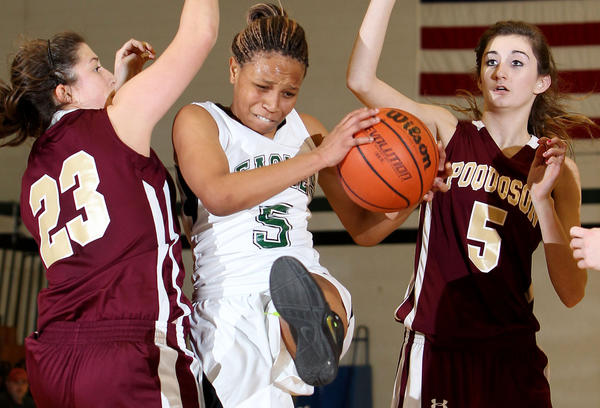 Aaliyah Lyttle of Jamestown pulls in an defensive rebound under pressure from Sydney Turner (23) and Toni-Anne Whitlow of Poquoson during the second half Thursday at Jamestown.