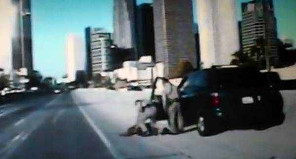 This CHP video still shows officers shortly after throwing Tamara Gaglione to the ground.