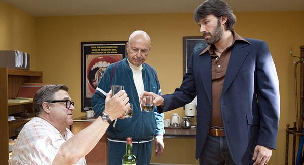"John Goodman, left, Alan Arkin, center, and actor-director Ben Affleck in a scene from ""Argo."""