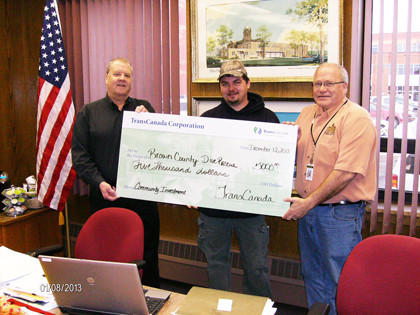 TransCanada recently donated $5,000 to the Brown County Dive Team. From left are Brown County Sheriff Mark Milbrandt, Mike Kost of TransCanada and Brown County Commissioner Duane Sutton.