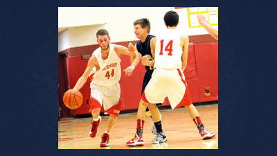 Rockwood's Logan Svonavec (14) sets a pick on Shade's Jeremy Pyles so teammate Brad Lemmon (44) can advance the ball in boys high school action Thursday night in Rockwood.