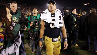 In this Nov. 17, 2012, file photo, Notre Dame linebacker Manti Te'o walks off the field following an NCAA college football game against Wake Forest in South Bend, Ind. A story that Te'o's girlfriend had died of leukemia _ a loss he said inspired him to help lead the Irish to the BCS championship game _ was dismissed by the university Wednesday, Jan. 16, 2013, as a hoax perpetrated against the linebacker.